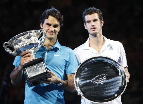Roger Federer (L) of Switzerland poses with Andy Murray of Britain with their trophies during the awarding ceremony after the fi
