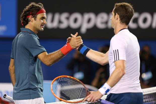 MELBOURNE, AUSTRALIA - JANUARY 22: Andy Murray of Great Britain shakes hands with Roger